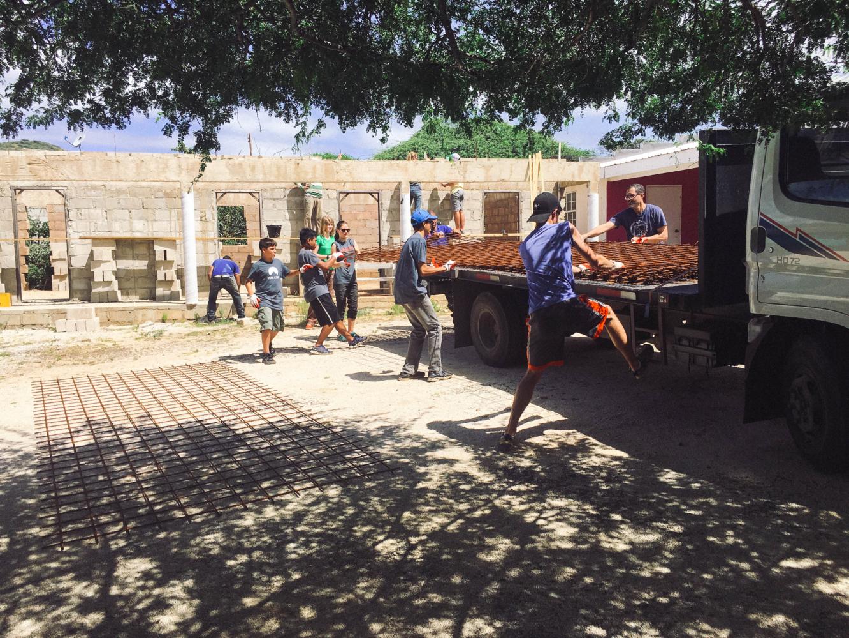 Students helping unload heavy metal