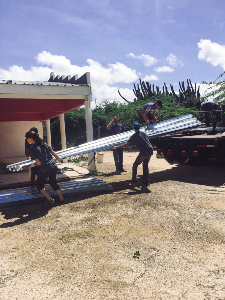 Students unloading supplies from a truck.