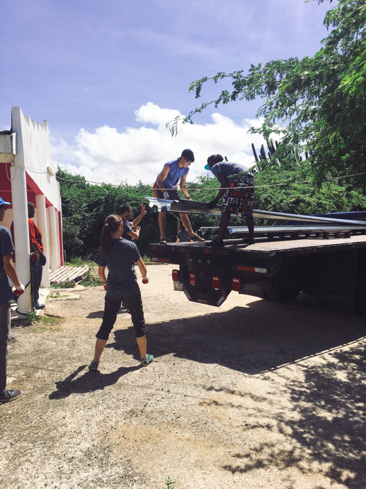 Students unloading heavy metal.
