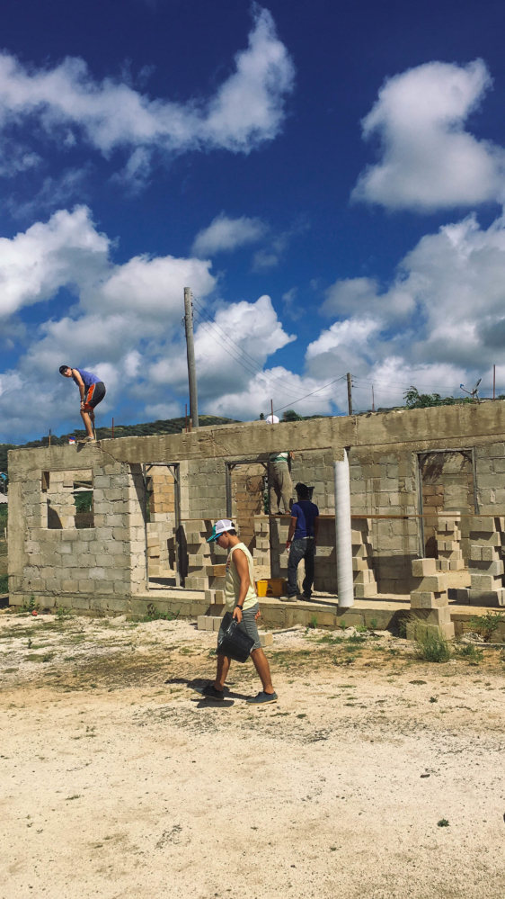 Students building the local Seventh Day Church.