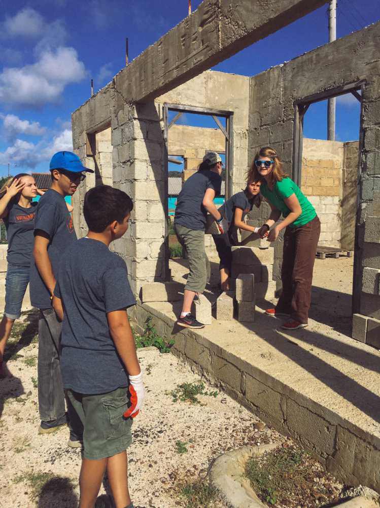 Students raising the pillars of the new building.